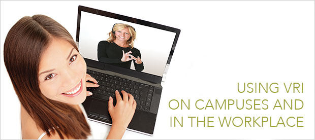 Woman using video remote interpreter on laptop
